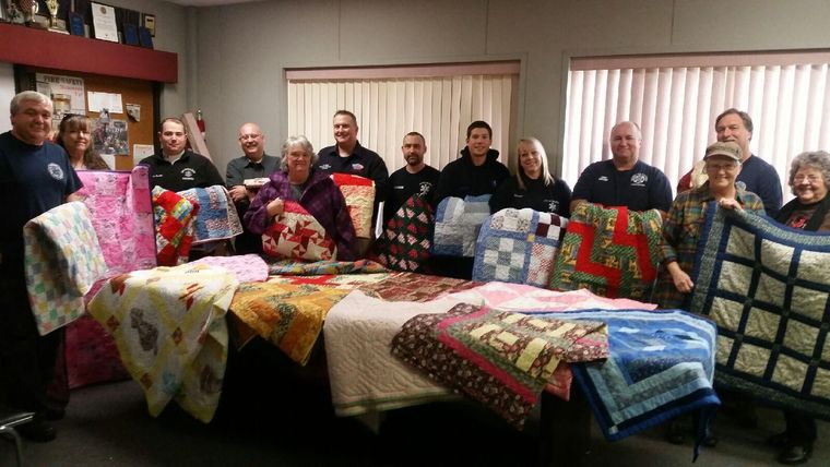 Wagoner's Gone to Pieces Quilt Guild donated 30 quilts Dec. 1 to Wagoner's EMS, Fire Department and Police Department. The quilts are to help the victims of emergencies, whether fire or crime, who may be in need of shelter when help arrives. This is their second year of donations.