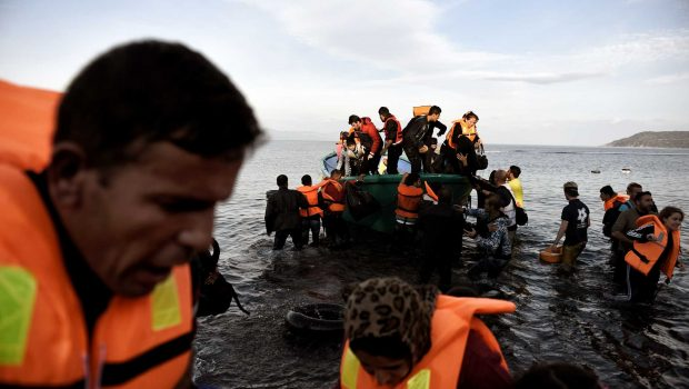 Refugees and migrants arrive on the Greek Lesbos island after crossing the Aegean Sea from Turkey on November 10, 2015. Lesbos and other Greek Aegean islands are at the forefront of the greatest migration challenge facing the European Union since World War II. Over 600,000 migrants and refugees, mostly from war-torn Syria, have landed in Greece this year, but nearly 500 have died in the Aegean. AFP PHOTO / ARIS MESSINISARIS MESSINIS/AFP/Getty Images