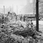 THE BRITISH ARMY IN THE UNITED KINGDOM 1939-1945 (H 9464) Royal Welch Fusiliers assist in clearing bomb damage in Belfast, Northern Ireland, 7 May 1941. Copyright: © IWM. Original Source: http://www.iwm.org.uk/collections/item/object/205196904