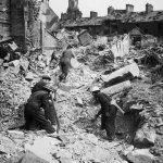 Rescue workers searching through rubble after an air raid on Belfast (Eglinton Street, Belfast 1941)